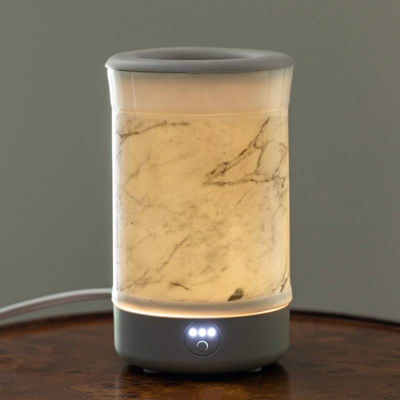 Happy Wax Marble Signature Wax Melt Warmer - Use our electric wax melter with any scented wax melts, cubes or tarts for hours of flame-free home fragrance. Our tabletop ceramic wax warmer features an integrated 3-6-9 hour time for automated home fragrance and a patent pending no scrape silicone wax melt dish.