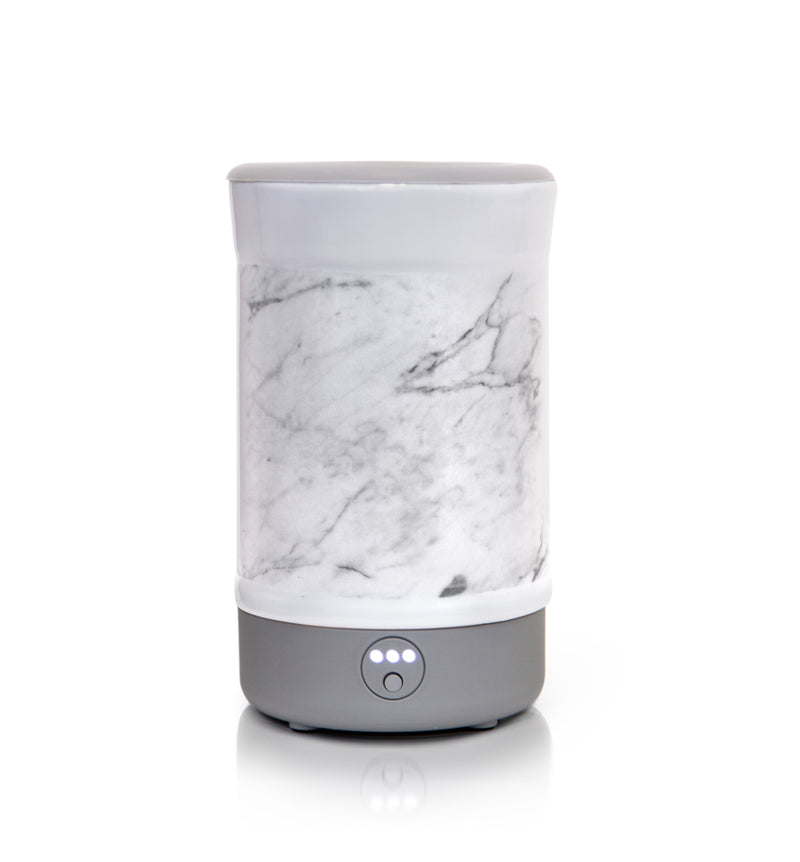 "Happy Wax - Marble Signature Wax Melt Warmer - Use our electric wax melt warmer with any scented wax melts, cubes or tarts for hours of flame-free home fragrance. Features an integrated 3-6-9 hour timer and a patent-pending ""no scrape"" silicone wax melt removal dish."