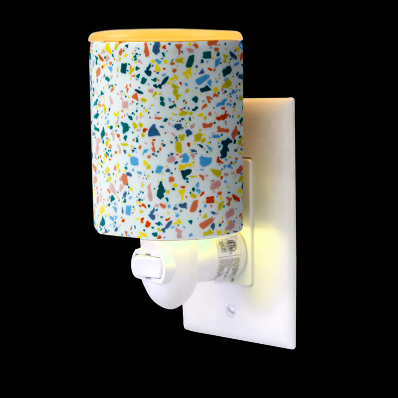 "Happy Wax - Terrazzo Outlet Plug-In Wax Warmer Kit - Our Happy Wax electric wax melt warmers include a patent-pending ""no scrape"" silicone dish for easy wax melt removal. Simply ""pop"" used wax right out to change scents in seconds. Use our wax warmers with any scented wax melts, cubes or tarts."