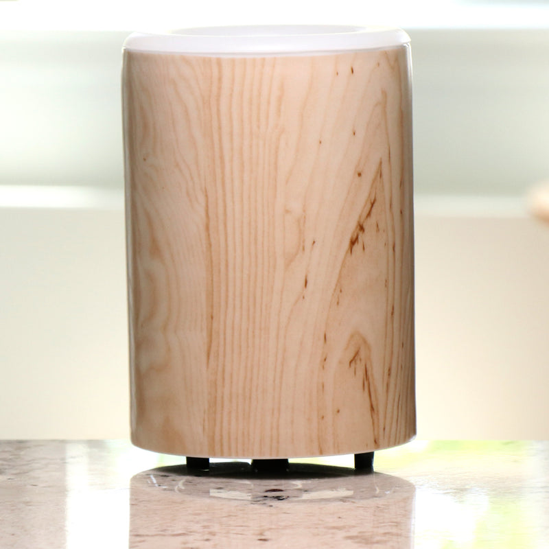 "Happy Wax Birch Wood Mod Warmer - The Mod Wax Melt Warmer is the perfect way to fragrance your home flame-free! A built-in ceramic heater gently warms any scented wax melt, cube, or tart releasing your favorite fragrances in minutes! Looking for a wax warmer with a timer? The Mod Wax Melt Warmer also includes our ""no scrape"" silicone wax melt removal dish. Simply ""pop"" used wax right out of the dish to change scents in seconds. The Mod Wax Warmer features a 3-6-9 hour auto shut off timer."
