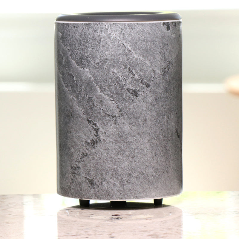 "Happy Wax Dark Stone Mod Warmer The Mod Wax Melt Warmer is the perfect way to fragrance your home flame-free! A built-in ceramic heater gently warms any scented wax melt, cube, or tart releasing your favorite fragrances in minutes! Looking for a wax warmer with a timer? The Mod Wax Melt Warmer also includes our ""no scrape"" silicone wax melt removal dish. Simply ""pop"" used wax right out of the dish to change scents in seconds. The Mod Wax Warmer features a 3-6-9 hour auto shut off timer."