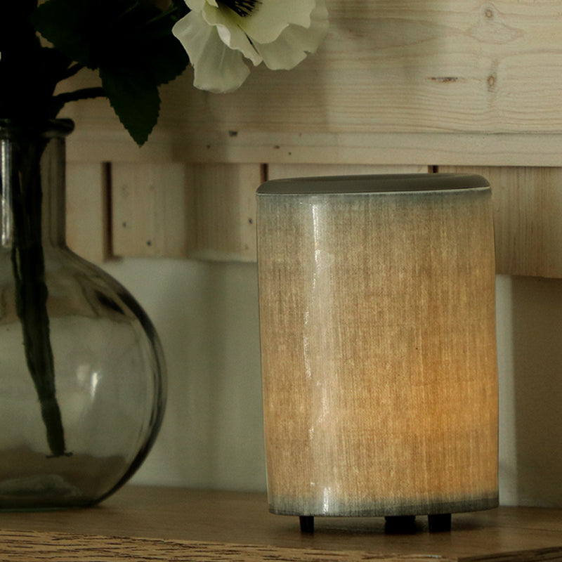 "Happy Wax Gray Linen Mod Warmer - The Mod Wax Melt Warmer is the perfect way to fragrance your home flame-free! A built-in ceramic heater gently warms any scented wax melt, cube, or tart releasing your favorite fragrances in minutes! Looking for a wax warmer with a timer? The Mod Wax Melt Warmer also includes our ""no scrape"" silicone wax melt removal dish. Simply ""pop"" used wax right out of the dish to change scents in seconds. The Mod Wax Warmer features a 3-6-9 hour auto shut off timer."