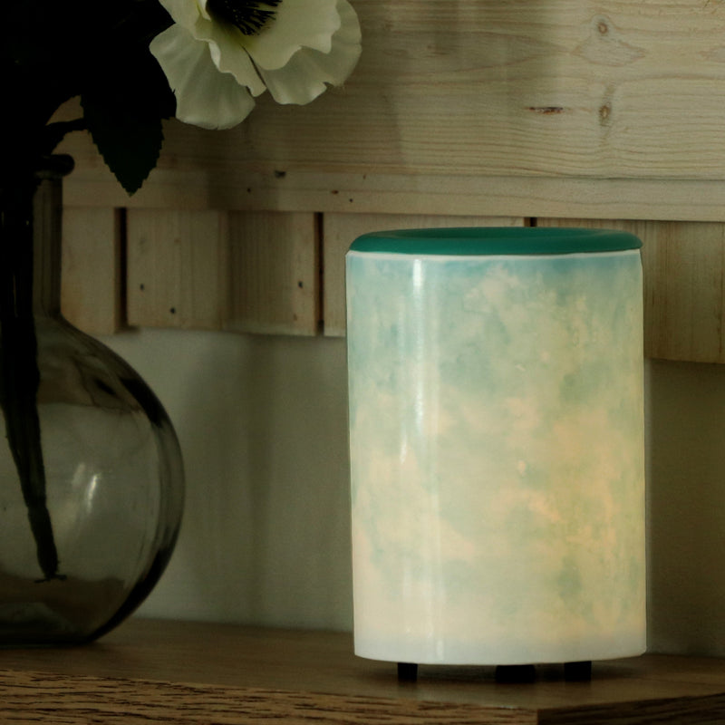 "Happy Wax Watercolor Mod Warmer - The Mod Wax Melt Warmer is the perfect way to fragrance your home flame-free! A built-in ceramic heater gently warms any scented wax melt, cube, or tart releasing your favorite fragrances in minutes! Looking for a wax warmer with a timer? The Mod Wax Melt Warmer also includes our ""no scrape"" silicone wax melt removal dish. Simply ""pop"" used wax right out of the dish to change scents in seconds. The Mod Wax Warmer features a 3-6-9 hour auto shut off timer."
