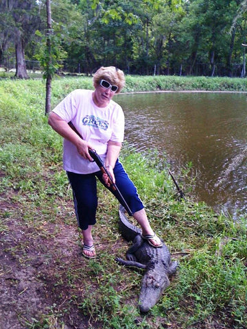 I'm the only gator in this swamp! Bayou Blake's mama, T-Lou, holds down a gator.