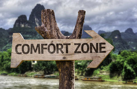 "arrow sign saying ""comfort zone""."