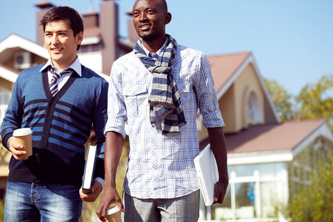 photo of two collegiate young men walking.