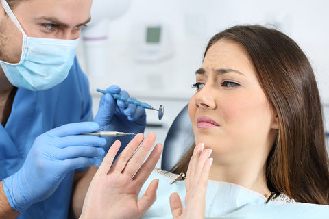 photo of a woman refusing a dental cleaning.