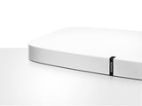 Partial view of a white Sonos Playbase