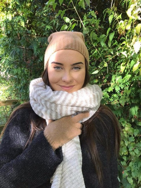 Model wearing beige and white mixed stripes large wool scarf. Made in Iceland from pure wool
