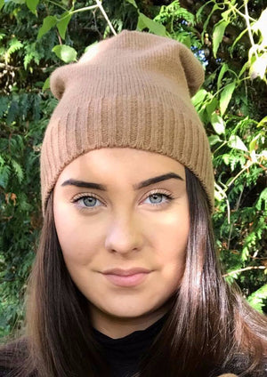 Model wearing beige angora beanie