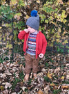 3 year old boy wearing a grey wool beanie with turkish pom