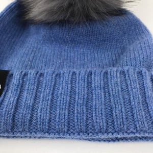Blue wool baby hat with a grey faux fur pom pom Varma wool clothing
