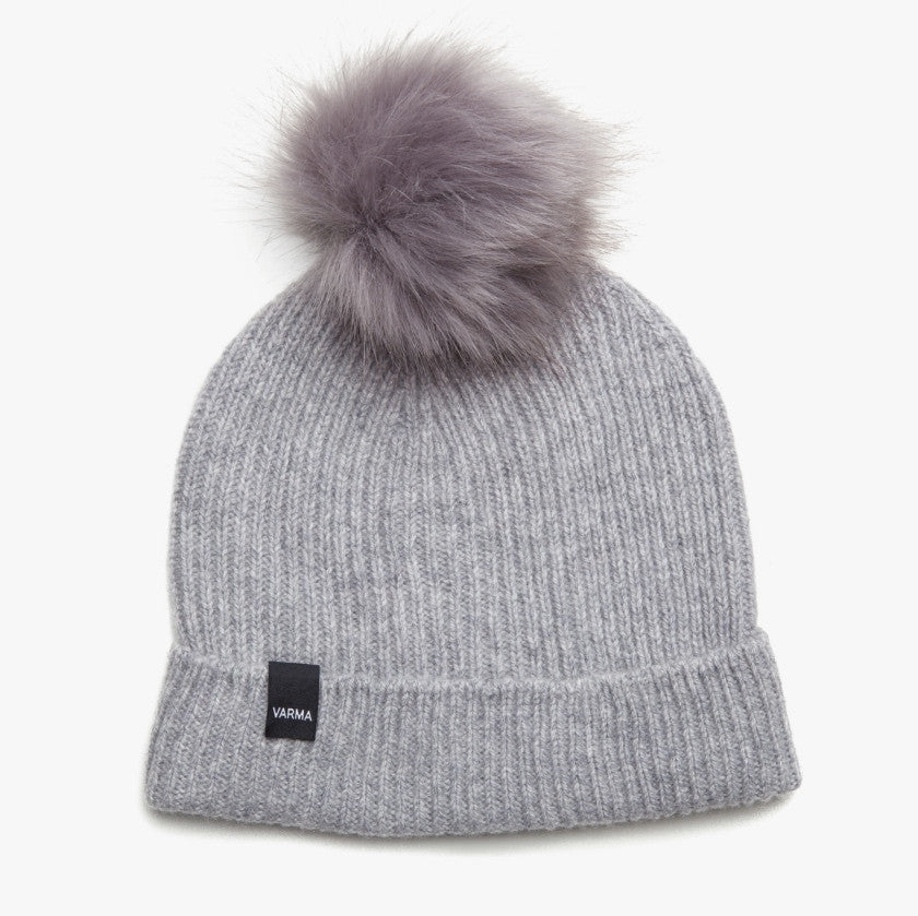 Light grey woman´s wool hat with grey pom pom