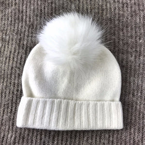 White baby hat with pom pom