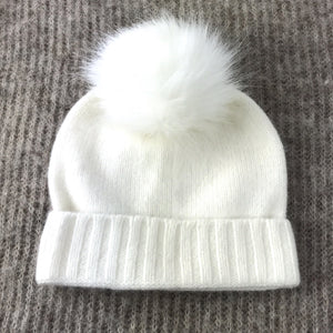 white woollen childrens beanie with faux fur pom pom Varma wool hat for toddlers