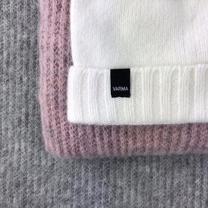 grey and pink wool throws and white woollen hat Varma