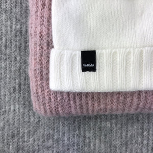 white woollen childrens hat and pink and grey soft wool throws from Varma