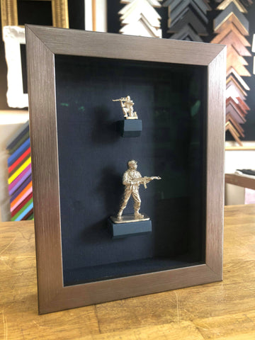silver toy soldiers framed.