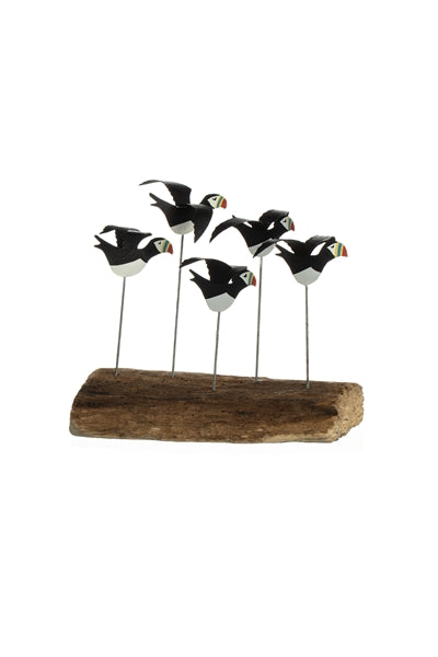 Flying puffins on a driftwood base