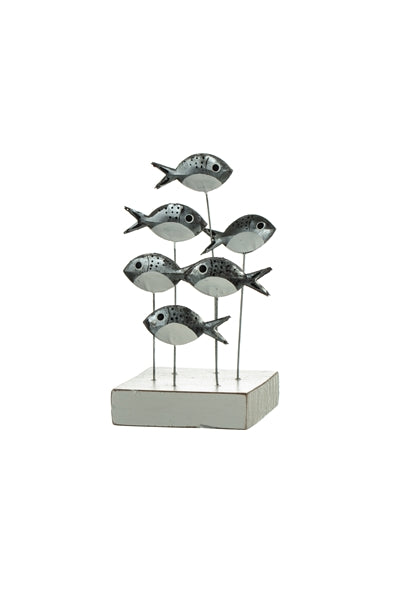 Swirl of silver bream on a wooden base