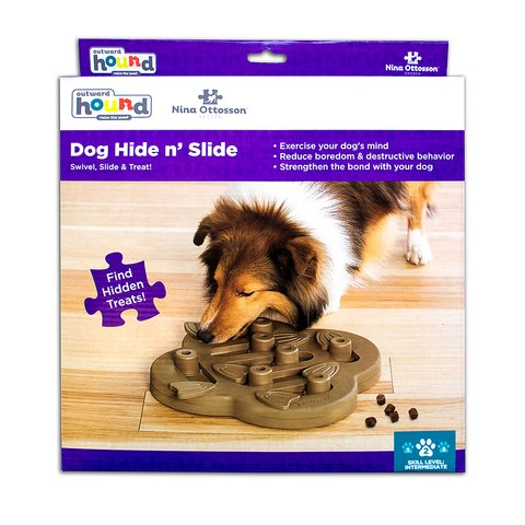 The Dog Hide n' Slide puzzle helps reduce destructive behavior and fights boredom by keeping your dog busy exercising their mind. A positive activity that will strengthen the human/canine bond. Fun for all dogs, regardless of age, size, or breed. Puzzle is made from a non-toxic composite material that is easy to clean! No removable parts.
