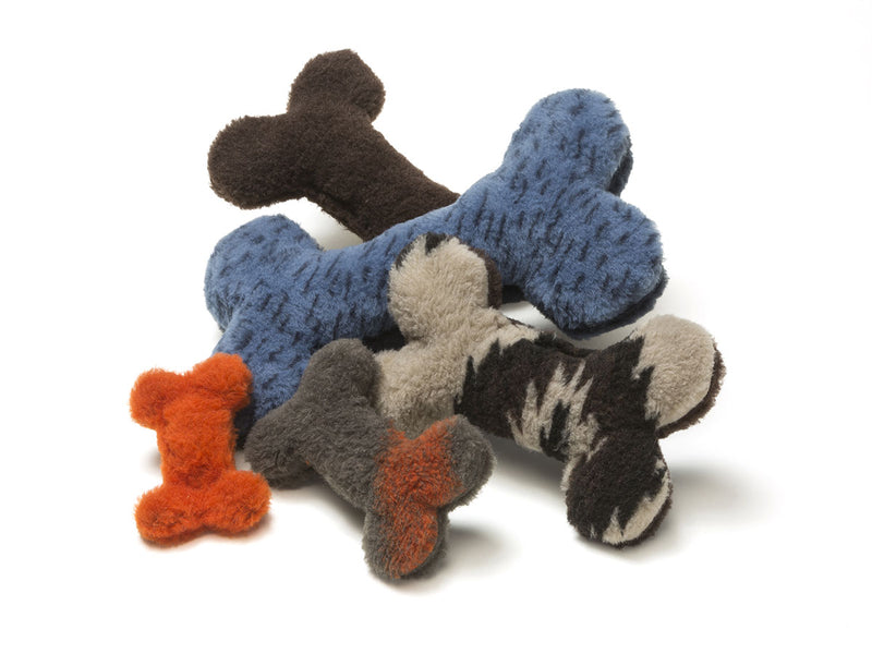 Throw the dog a bone already! The Montana Bones are sure to delight any dog with its attention-grabbing squeaker and eye-catching colors.   Made of 100% eco-friendly IntelliLoft fabric and fill.