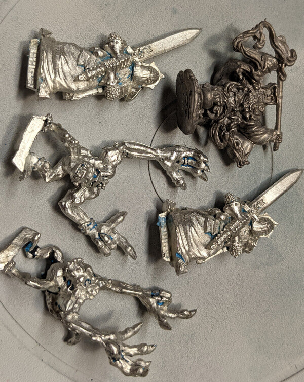 Strip paint from miniatures