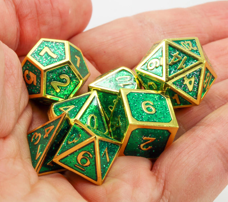 Green and gold enamel dice