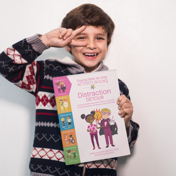Boy Holding Distraction Detour Activity Book