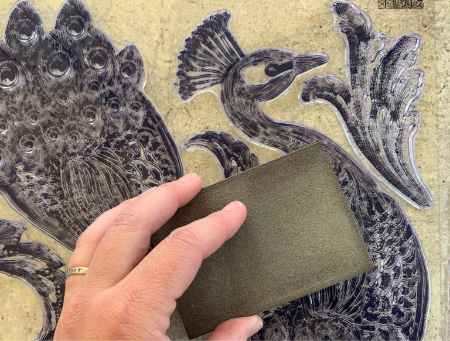 peacock iron orchid design stamp being sanded