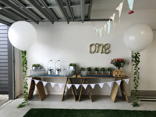 wild one rustic woodland cake table drinks station