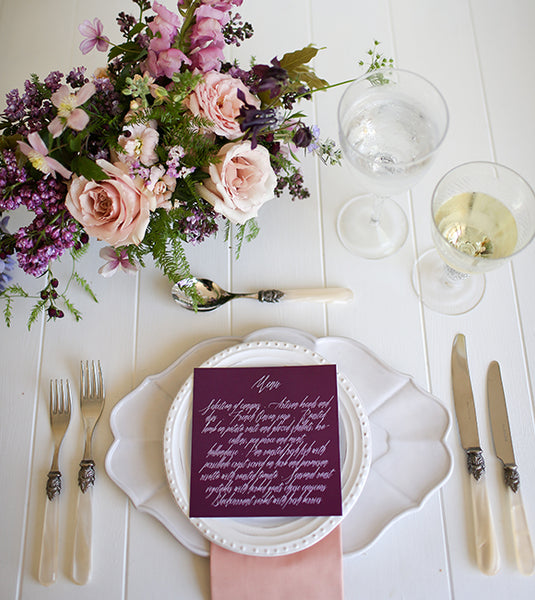 Plum wedding themed dinner setting