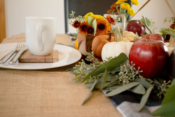 Thanksgiving tablescape with mini pumpkins and red apples