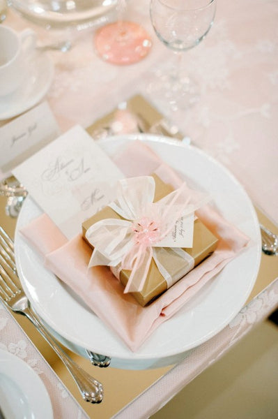 Blush and gold wedding dinner setting