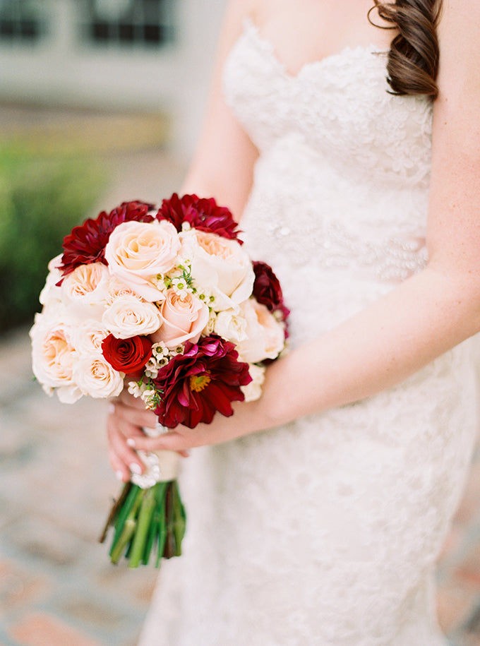 Marsala and blush bouquet held by bride