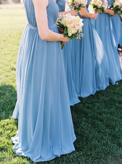 Bridesmaids in french blue dresses holding wedding bouquets