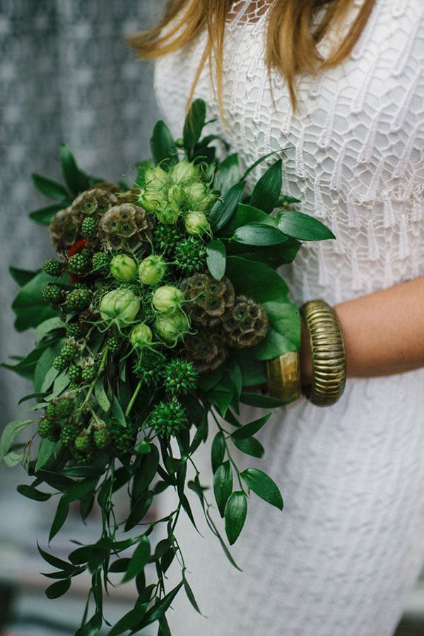 Bride holding green spring bouquet
