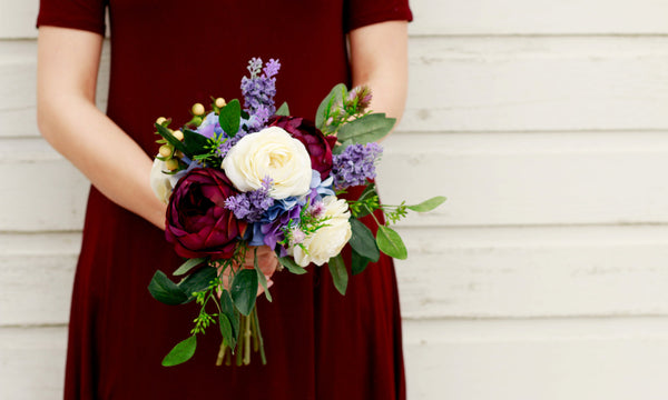 Bride holding lavender and burgundy wedding bouquet