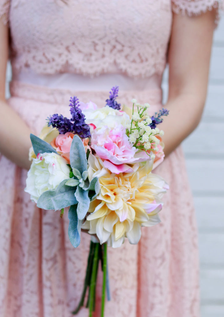 Marmalade Floral silk pastel bouquet held by bride