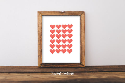 Wood-framed print of a grid of coral hearts