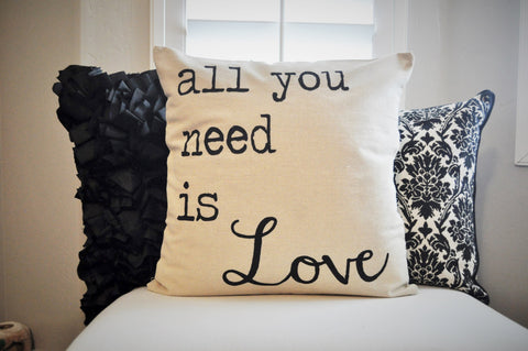 Pillow with screen printed message of 'All you need is Love'