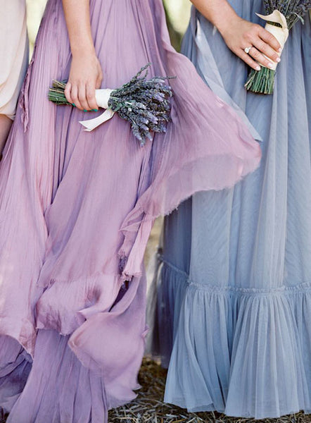 Bridesmaids in lavender dresses holding bouquets