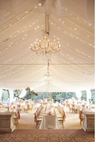 Gold and pink blush wedding tables under open tent