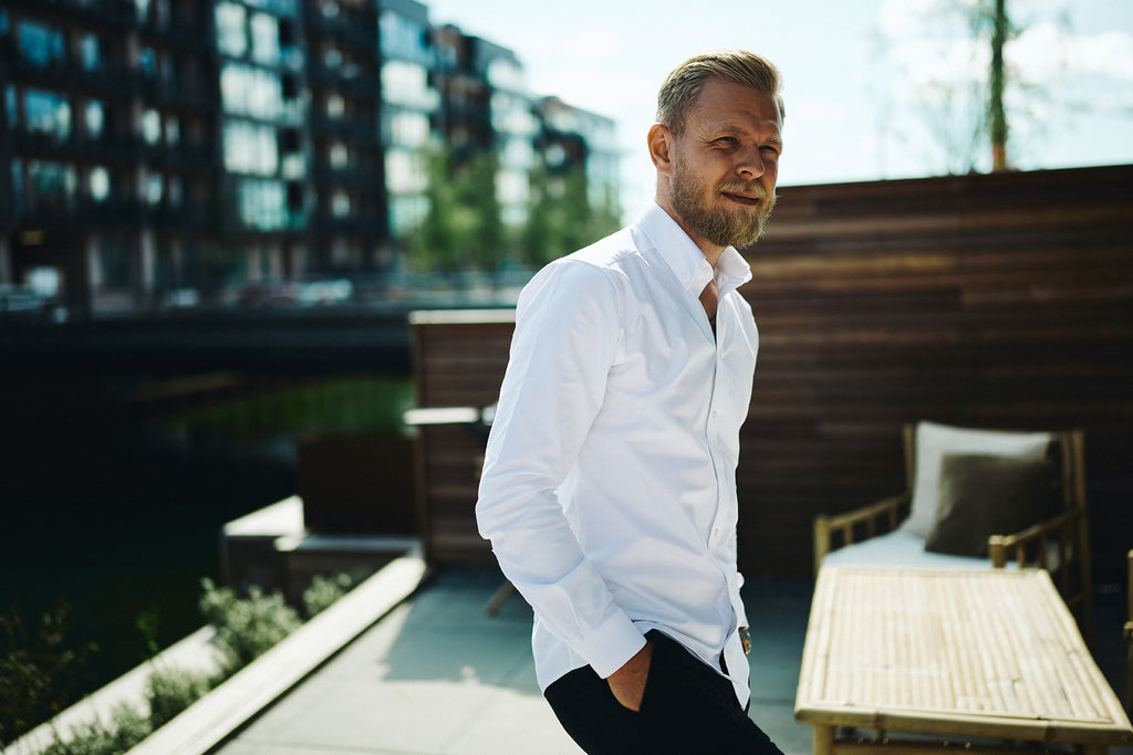 Kevin magnussen by water in white Barons shirt