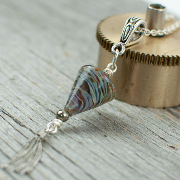 Mahogany striped cone shaped borosilicate glass and silver tassel necklace