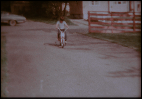 Girl Riding Bike with Training Wheels 1973