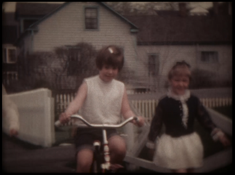 Girl on a Bike with Training Wheels 1970