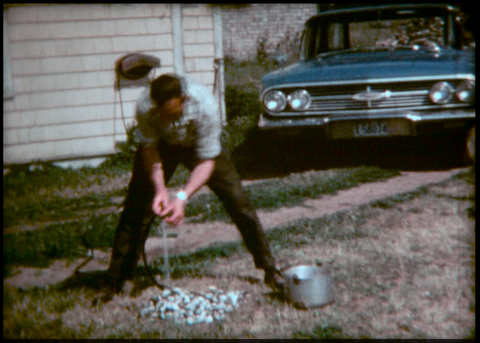 Man Cleaning Clams to Boil 1967