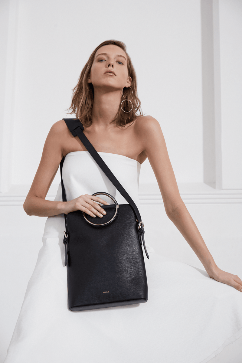 X NIHILO Julie work crossbody bag in black, fashion bag with chrome hardware, adjustable shoulder strap, zip top closure, luxury black textured leather handbag, genuine leather bag