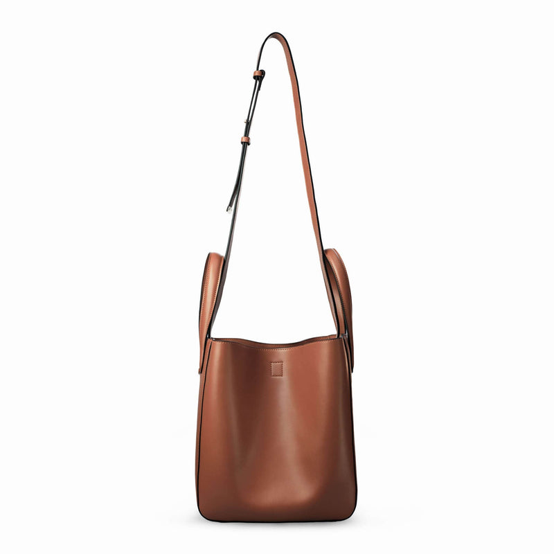 X NIHILO Eight in tan bag, fashion bag with single snap button top closure, soft gold hardware, and adjustable shoulder straps, luxury cow nappa leather handbag, genuine leather bag